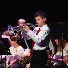 kid playing trumpet