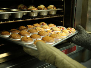 tray of muffins coming out of oven